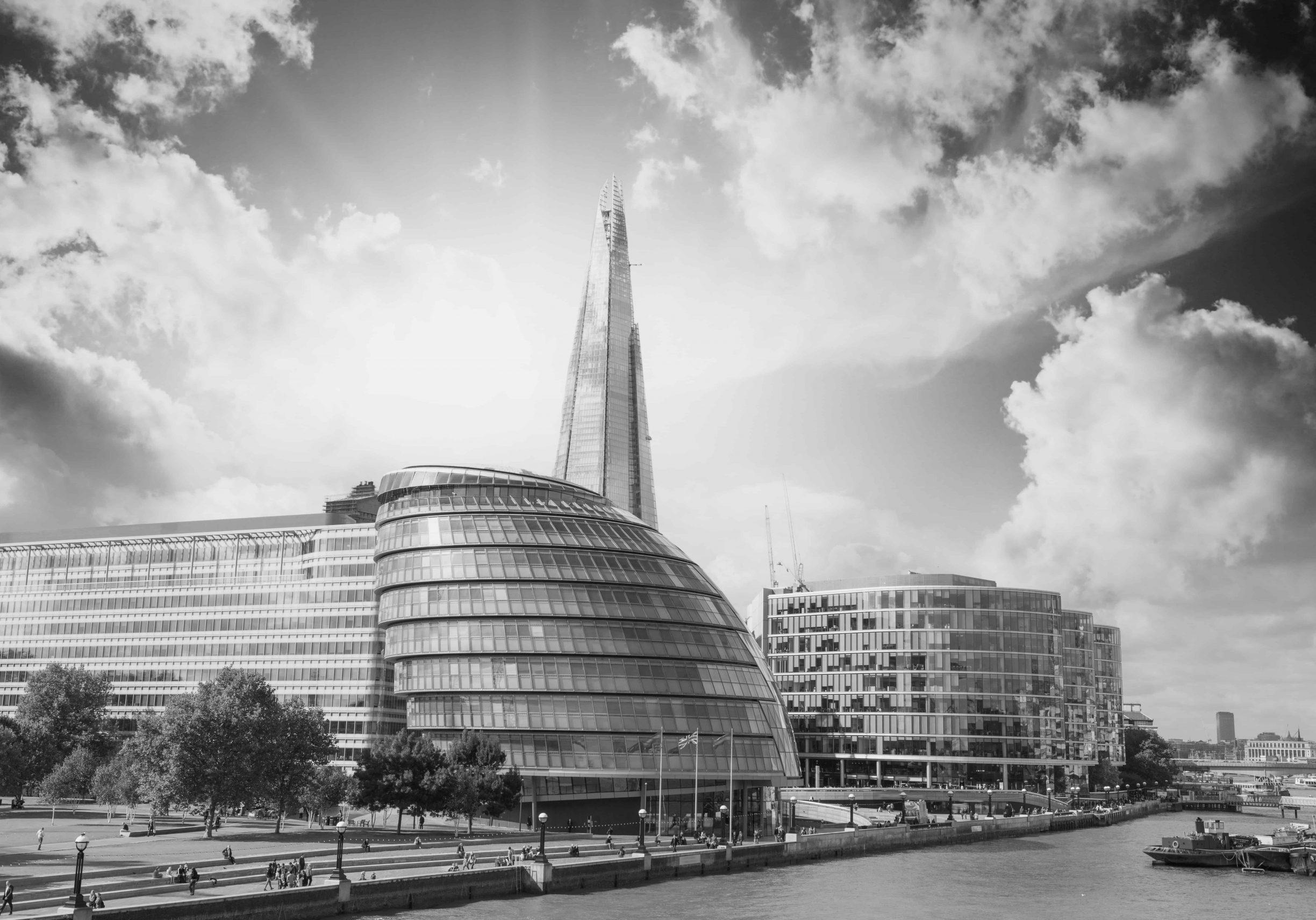 New London city hall with Thames river and cloudy sky, panoramic view from Tower Bridge - UK
