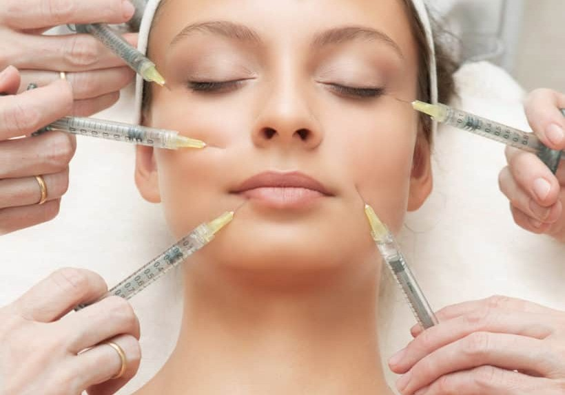 The Beautiful Young Woman Having Rejuvenating Injection against the Wrinkles